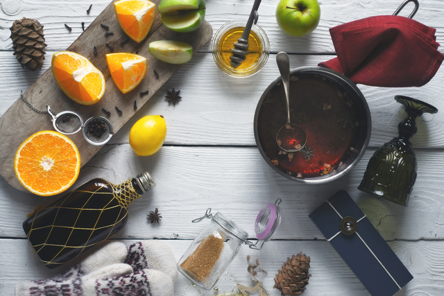 Ingredients for mulled wine on the white wooden table top view